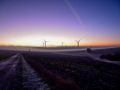 Windräder bei Sonnenaufgang / wind turbines at sunset